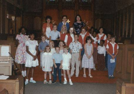 Carol Choir circa 1990s with Dr. Maribeth Montgomery Kasik as director; Mrs. Doris Cox as Accompanist; Mrs. Dorothy Connie as helper...  Included in this picture are Kubajak family, Connie, kids, Clay family Rolphe, Deandre, Jamie Kasik, Ryan Cox and others