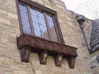 Flower Box immediately below the second story of the fireside entrance. Depecting from left to right: the Anchor of hope; Cup of Christ's suffering; Blazed Cross of Christ's triumph and the Sword and Key representing Victory and the key to Heaven.