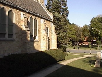 Sidewalk to fireside room and South side of exterior of church